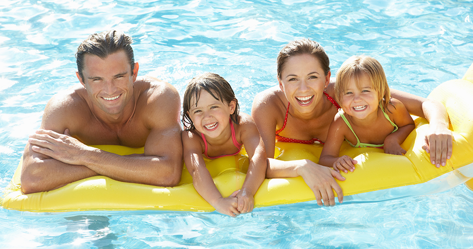 happy family on swimming pool float, above ground pool, above ground pools, on ground pools, north carolina, nc,mcewen,mcewen industries,swimming pool manufacturer,swimming pool distributor,